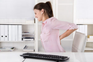 Woman with bad back Shutterstock_226745545