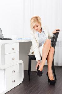 Woman in high heels in office Shutterstock